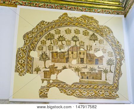 TUNIS TUNISIA - SEPTEMBER 2 2015: The ancient mosaic depicts the Roman villa and farm surrounded by the fruit garden Sousse Room of Bardo National Museum on September 2 in Tunis.