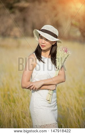 attractive young woman enjoying her time outdoors in summer sunset lights close up portrait