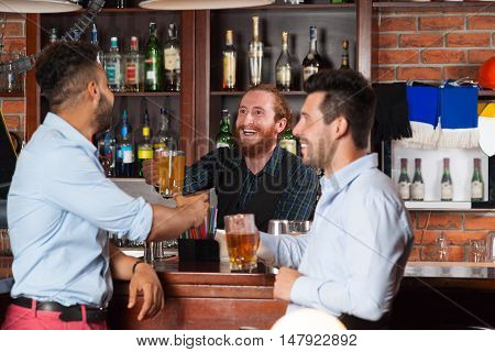 Two Man In Bar At Counter, Barman Giving Beer Glass, Friends Meeting Guys Cheerful Smiling Happy Communication Celebration