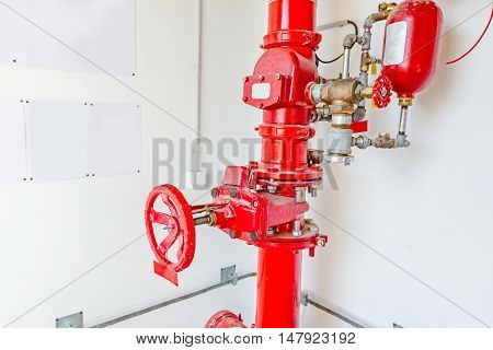 Master valve for water supply fire fighting system control and pipeline is painted in red.