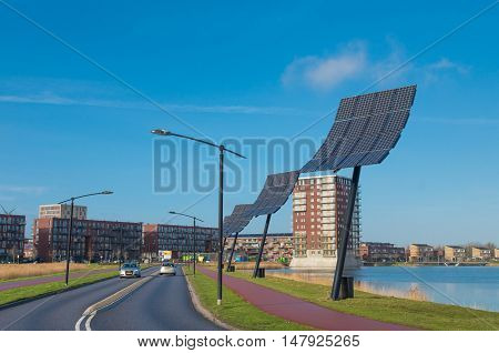 HEERHUGOWAARD NETHERLANDS - JANUARY 23 2016: Entrance of the city of the sun the largest energy neutral residential area in the world. It produces as much energy as it consumes using 3.75 megawatt photovoltaic solar panels and 3 wind turbines