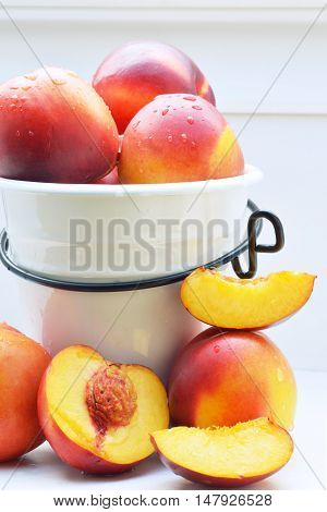 fresh colorful nectarines in and arround a pot