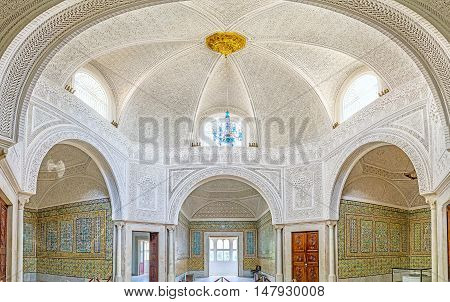 TUNIS TUNISIA - SEPTEMBER 2 2015: The Virgil Room of Bardo National Museum is the former harem of Hafsid Palace decorated with patterns of glazed tiles and carved ganch on September 2 in Tunis.
