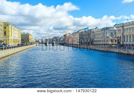 The embankments of Fontanka River with old mansions and great palaces and the Lomonosov bridge in front St Petersburg Russia.
