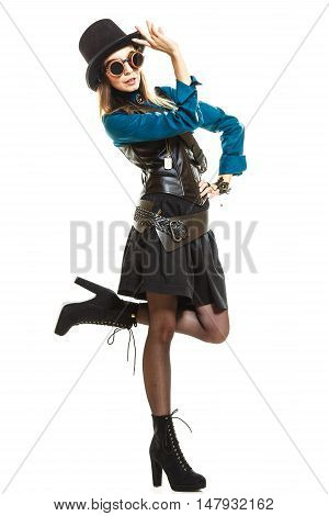 Young steampunk islolated girl on white wearing fancy hat posing. Fantasy old fashion with styling topper and goggle.