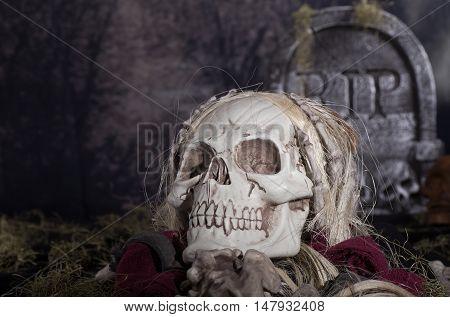 Halloween grim reaper skull in a graveyard