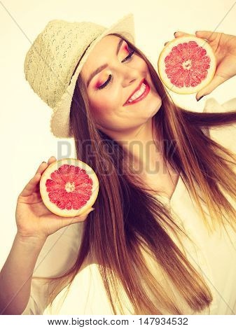 Woman Holds Two Halfs Of Grapefruit Citrus Fruit In Hands