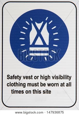 A blue and white vest safety sign.