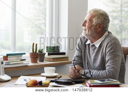 Senior Adult Looking Outside WIndow Relax Concept
