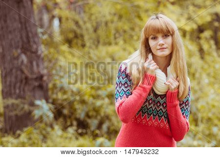 Fall concept - autumn woman in park. Beautiful young modern woman smiling happy and cheerful