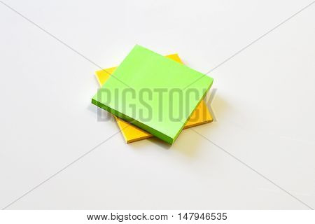 green and yellow post-it in new condition