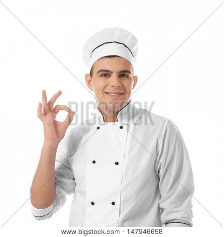 Young handsome chef cook isolated on white