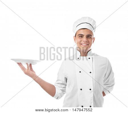 Young handsome chef cook with plate isolated on white