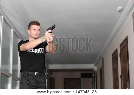 Security man is going to shoot from gun
