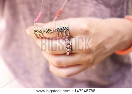 Young woman with beautiful accessories, close up