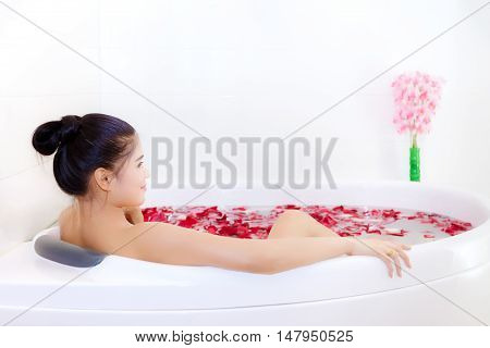 Beautiful Asian Woman Takes A Bath In Jacuzzi With Rose Petals In Thai Massage Spa Salon., Beauty Sp