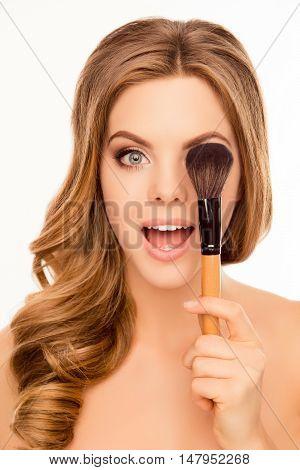 Happy Cheerful Woman Hiding Eye Behind Makeup Brush