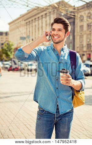 Handsome Smiling Tourist With Cup Of Coffee Talking On Phone