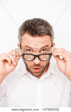 Portrait Of Young Surprised Businessman Taking Off His Glasses