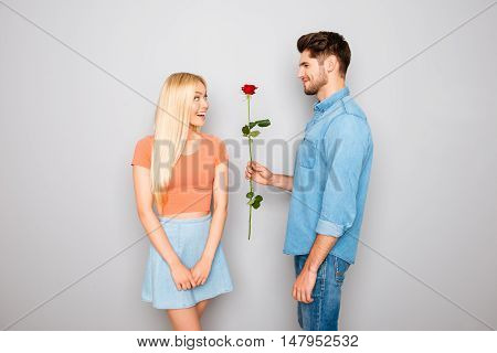 Young Handsome Man With Red Rose Having Date With His Girlfriend