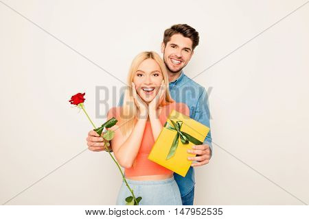 Portrait Of Excited Happy Girl Receiving Presents From Her Boyfriend