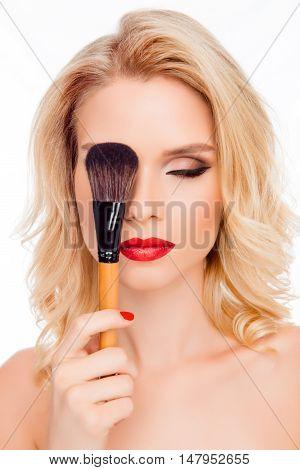 Sexy Pretty Blonde Hiding Eye Behind Makeup Brush