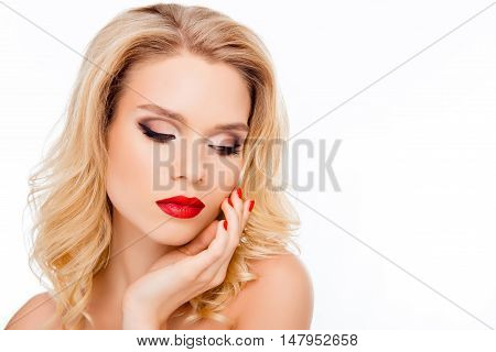 Sensual Sexy Blonde With Red Lips Touching Her Face