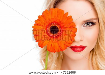 Attractive Happy Girl Hiding Half Of Her Face Behind Gerbera