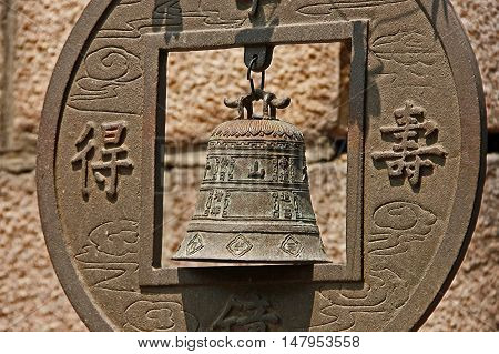 Аncient chinese bell in monastery, with rust