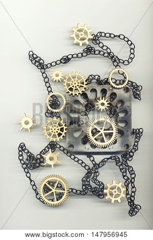 Abstract image with gears, chain and a metal object