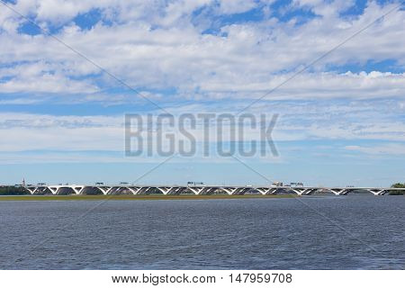 A view on Woodrow Wilson Bridge from National Harbor Oxon Hill Maryland USA on bright sunny morning. A bascule bridge across Potomac River connects Virginia and Maryland states.