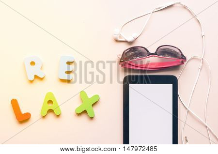 The Colorful Canvas Shoe And Sunglasses With Relax Alphabet On The Floor Ground Background In Warm T