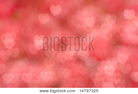 abstract red blur background with pink hearts