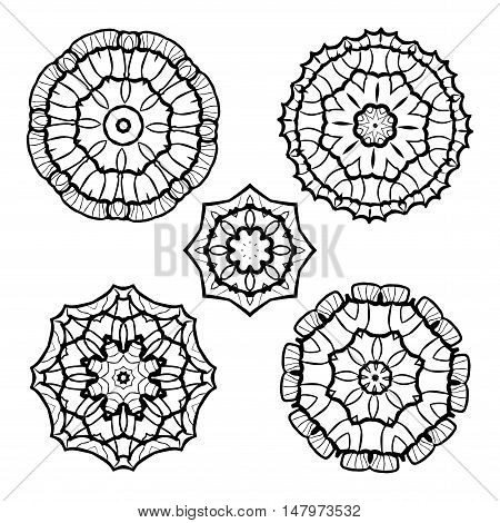 Vector set from five round black and white mandalas. Vector mandalas. Ethnic decorative elements. Hand drawn mandalas.