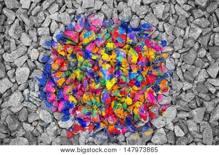 Conceptual abstract background. Multicolored stones in the middle of the black and white stones