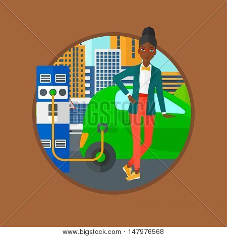 An african-american woman charging electric car at charging station. Woman standing near power supply for electric car charging. Vector flat design illustration in the circle isolated on background.