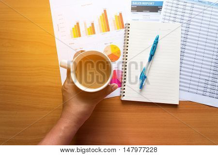 Sales Managers Working Modern Studio.Woman Showing Hand Market Report Charts.Marketing Department Planning New Strategy.Researching Process Wood Table.Horizontal.Blurred Background.Film effect.