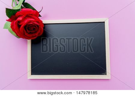 Teacher's day background.Black chalk board frame empty copy space and fresh flowers in vase.Holiday feminine poster