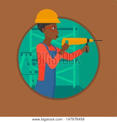 An african-american female worker drilling a hole in the wall. Young woman in overalls and hard hat working with hammer drill. Vector flat design illustration in the circle isolated on background.