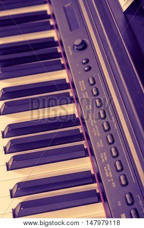 Key electronic piano closeup. close frontal view.