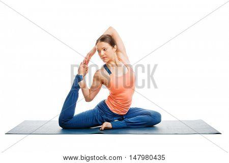Hatha yoga - sporty fit woman doing yoga asana Eka pada kapotasana - one-legged pigeon pose isolated on white