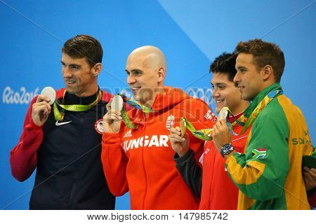RIO DE JANEIRO, BRAZIL - AUGUST 12, 2016: Michael Phelps USA (L), Laszlo Cseh HUN,Joseph Schooling SGP and Chad le Clos RSA during medal ceremony after Men's 100m butterfly of the Rio 2016 Olympics