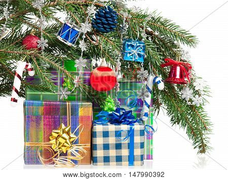Fir-tree branch with christmas gifts isolated on white background
