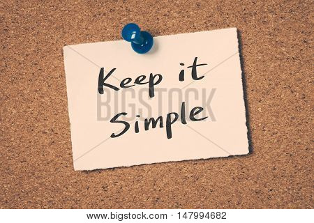 Keep it simple note pin on the bulletin board