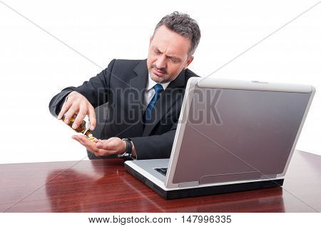 Business Man Looking Stressed Taking Pills