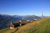 Popular travel destination Mt Niederhorn in summer. Summit station of a cable car. Swiss Alps. poster