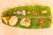 Traditional Onam Feast on banana leaf - a South Indian vegetarian meal on banana leaf served during festival seasons especially in Kerala, India poster