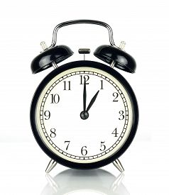Alarm Clock isolated on white in black and white showing one o'clock.