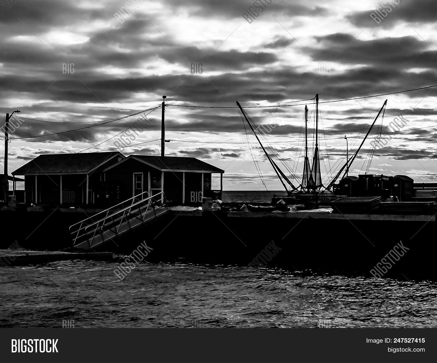 An artsy view in black and white of a fishing boat on prince edward island