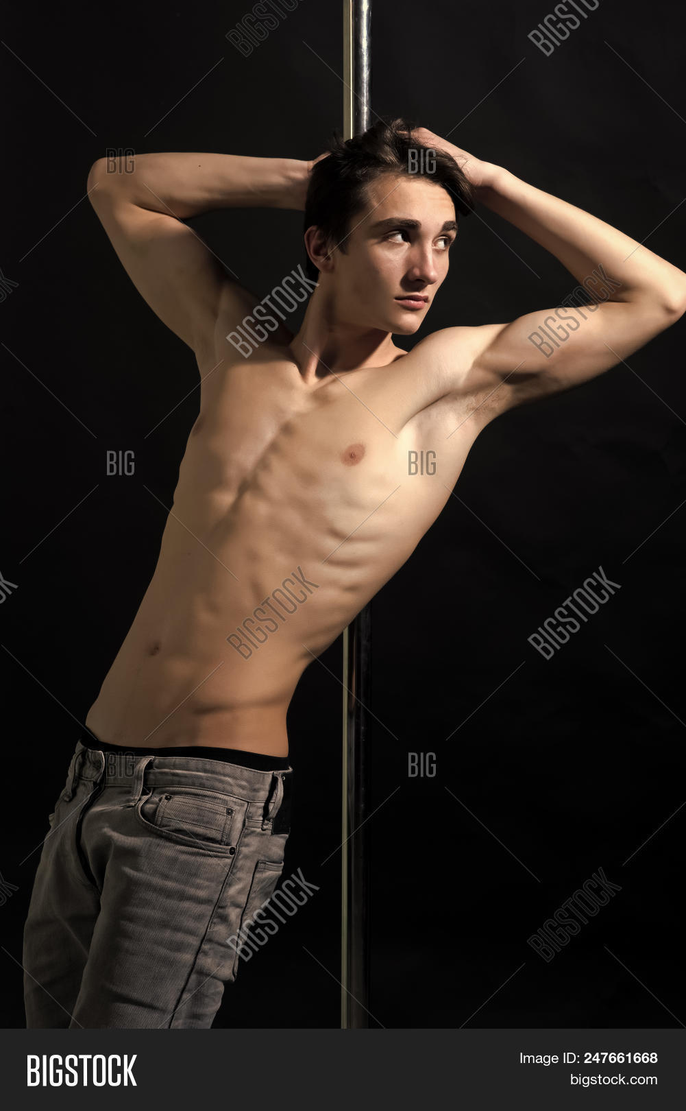 Dancer On The Pylon. Young Strong Pole Dance Man With Nude Torso Lean On  Metallic